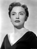 Joan Leslie Showing a Serious Face, wearing a Black V-Neck Dress in Portrait Photo by  Movie Star News
