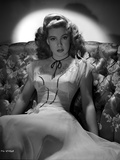Gloria DeHaven sitting On A Couch in Gown in Black and White Photo by  Movie Star News