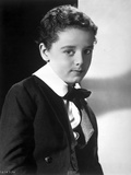 Freddie Bartholomew sitting on Chair With Leg's Cross Photo by  Movie Star News