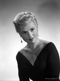 Judy Holliday wearing a V-Neck Dress and Earrings in a Portrait Photo by  Movie Star News
