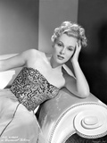 Eva Gabor on a Embroidered Top sitting on a Couch Photo by  Movie Star News