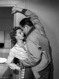 Human Desire Man in Jacket Kissing Woman in Printed Long Sleeve Polo Photo by  Movie Star News