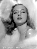 Evelyn Keyes Surrounded with Furr and posed Photo by  Movie Star News