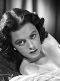 Faith Domergue Reclined in Black and White Portrait Photo by  Movie Star News
