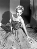 Eva Gabor on a Embroidered Top sitting on the Floor Photo by  Movie Star News