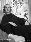 Frances Farmer on a Dark Dress and sitting on Chair Photo by  Movie Star News