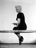 Judy Holliday sitting with Legs-Crossed Photo by  Movie Star News