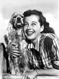 Gail Russell smiling with Furry Dog Photo by  Movie Star News