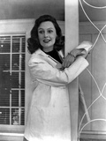 Geraldine Fitzgerald on Doctor's Uniform smiling Photo by  Movie Star News