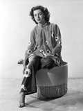 Faith Domergue Seated on Round Chair in Floral Dress Photo by  Movie Star News