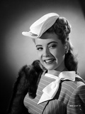 Gloria DeHaven smiling in A Portrait in Black and White Photo by  Movie Star News