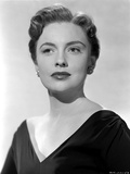 Joan Leslie wearing a Black V-Neck Dress with Earrings in Portrait Photo by  Movie Star News