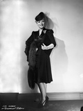 Eva Gabor on Dark Dress Leaning on Wall Portrait Photo by  Movie Star News