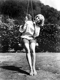 Eva Saint Swinging in Classic Photo by  Movie Star News