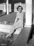 Frances Farmer on a Swimsuit sitting on a Pool Side Photo by  Movie Star News
