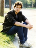 John Cusack sitting on the Side Walk Photo by  Movie Star News