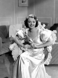Janet Gaynor on a Silk Gown sitting Photo by  Movie Star News