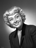 Joan Blondell on a Leaning and smiling Portrait Photo by  Movie Star News