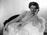 Irene Castle sitting and Leaning on a Couch in Gown Photo by  Movie Star News