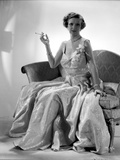 Irene Castle wearing a Silk Gown with Hand Raised Photo by  Movie Star News