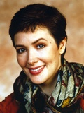 Janine Turner Portrait in Floral Scarf Photo by  Movie Star News