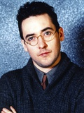 John Cusack wearing a Sweater and Glasses Photo by  Movie Star News