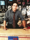 John Shea wearing a Blue Shirt with Black Necktie in a Portrait Photo by  Movie Star News