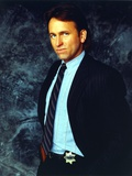 John Ritter wearing a Black Suit in a Close Up Portrait Photo by  Movie Star News
