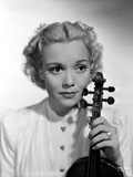 Jane Wyman Portrait in White Long Sleeve Shirt with Hand Holding a Violin Photo by  Movie Star News