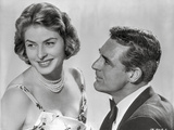 Indiscreet Couple Lady in Printed Dress with Pearl Necklace with a Man in Suit and Tie Photo by  Movie Star News