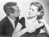 Indiscreet Lady Combing Her Hair with a Man in Suit Photo by  Movie Star News