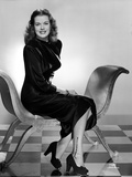 Janis Paige sitting on a Chair in Black High-Neck Long Sleeve Velvet Dress and Black High Heel Shoe Photo by  Movie Star News