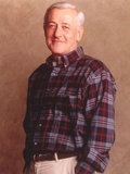 John Mahoney smiling in Polo Photo by  Movie Star News