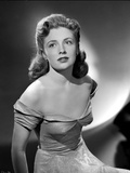 Joan Leslie on an Off Shoulder Silk Dress sitting and posed Photo by  Movie Star News