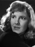 Jean Arthur Portrait in Black Cotton Dress with Eyes Looking Away Photo by  Movie Star News