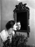 Laura La Plante smiling on a Mirror in a White Top Photo by  Movie Star News