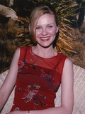 Kirsten Dunst smiling in Red Dress Photo by  Movie Star News