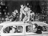 Johnny Weissmuller Riding on Top of a Car in a Classic Movie Scene Photo by  Movie Star News