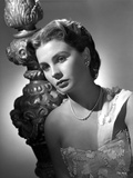 Jean Simmons Portrait in White Single Strap Embroidered Silk Dress and Pearl Necklace Photo by  Movie Star News