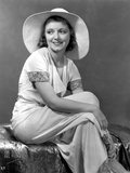 Janet Gaynor on a Dress with Hat sitting Portrait Photo by  Movie Star News