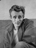 James Dean Portrait in Black Jacket and Heat Turn to the Left with Left Arm Rest on the Right Leg Photo by  Movie Star News