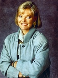 Jane Curtin Portrait in Blue Herringbone Velvet Coat and Pale Blue Scarf with Arms Crossed Photo by  Movie Star News