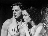 Johnny Weissmuller Hugged by a Woman in a Movie Scene Photo by  Movie Star News