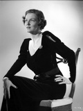 Irene Castle sitting on a Wooden Chair in Black Dress Photo by  Movie Star News