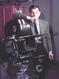 Jack Webb Portrait in Black Suit with Camera Photo by  Movie Star News