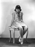 Jane Withers Seated on a Chair in White Polka Dot Short Sleeve Blouse with Hands Rest on the Side a Photo by  Movie Star News