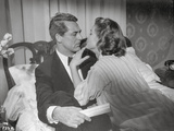 Indiscreet Man and Lady on Bed Photo by  Movie Star News
