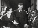 Imitation Of Life Lady in Pearl Necklace with Men in Suit and Tie Photo by  Movie Star News