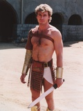 Jon-Erik Hexum wearing a Gladiator Costume with a Blade in a Close Up Portrait Photo by  Movie Star News