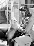 Joan Leslie on a Blazer and Holding a Dog Photo by  Movie Star News
